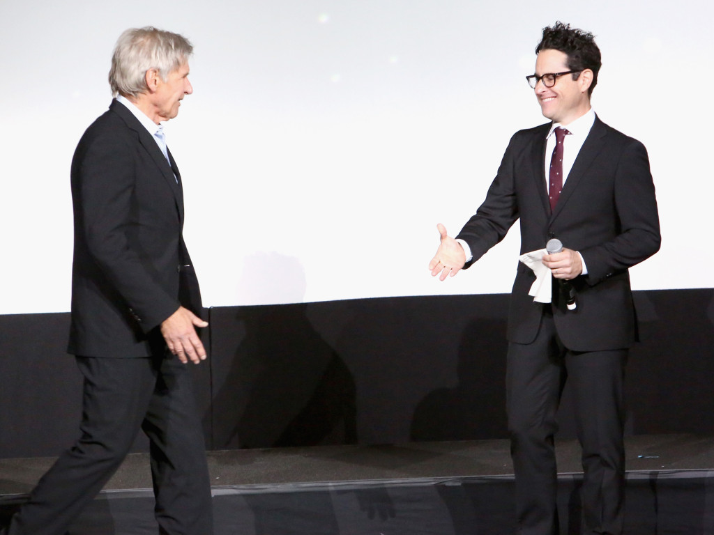 HOLLYWOOD, CA - DECEMBER 14: Actor Harrison Ford (L) and director J.J. Abrams attend the World Premiere of ?Star Wars: The Force Awakens? at the Dolby, El Capitan, and TCL Theatres on December 14, 2015 in Hollywood, California. (Photo by Jesse Grant/Getty Images for Disney) *** Local Caption *** Harrison Ford;J.J. Abrams