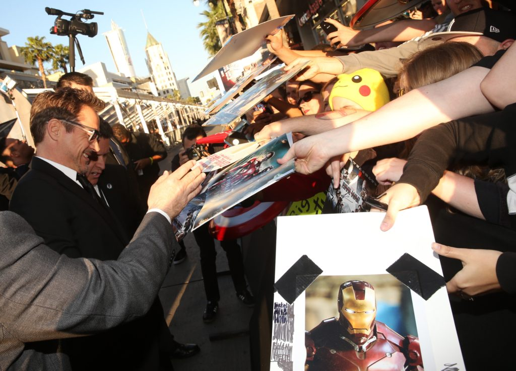 """HOLLYWOOD, CALIFORNIA - APRIL 12: Actor Robert Downey Jr. signs autographs during The World Premiere of Marvel's """"Captain America: Civil War"""" at Dolby Theatre on April 12, 2016 in Los Angeles, California. (Photo by Jesse Grant/Getty Images for Disney) *** Local Caption *** Robert Downey Jr."""