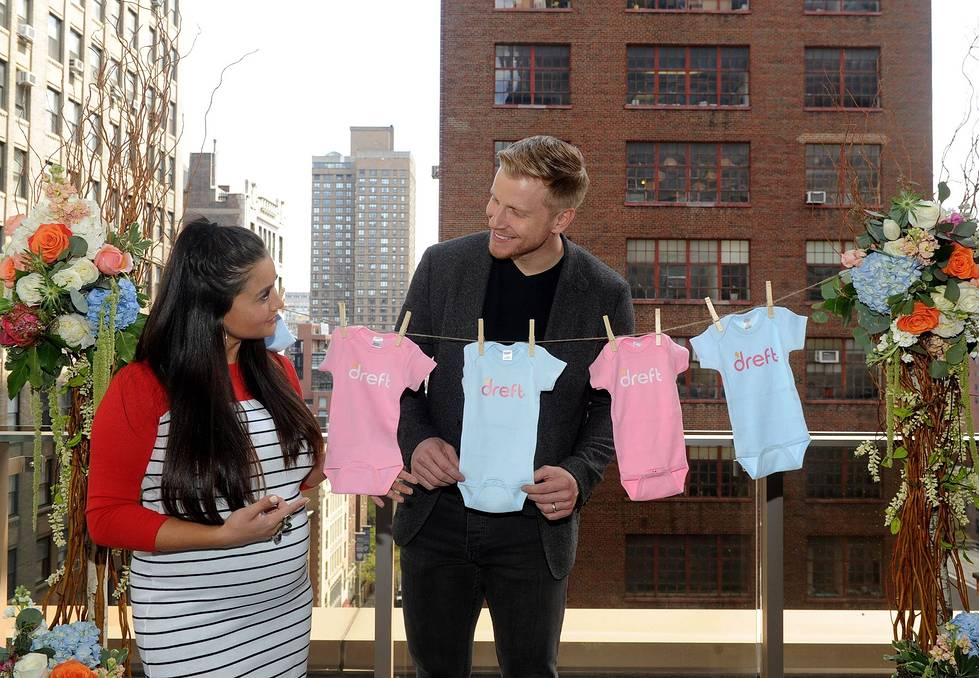 "Reality TV couple Sean and Catherine Lowe celebrate their pregnancy at the Dreft ""Loads of Love"" baby shower. (Diane Bondareff/Invision for Dreft/AP Images)"