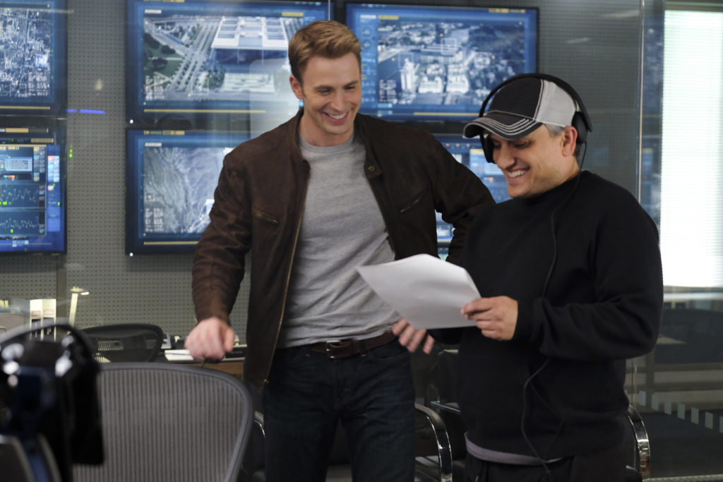 Captain America: Civil War L to R: Chris Evans (Captain America) on set w/ Director Joe Russo Ph: Zade Rosenthal ©Marvel 2016