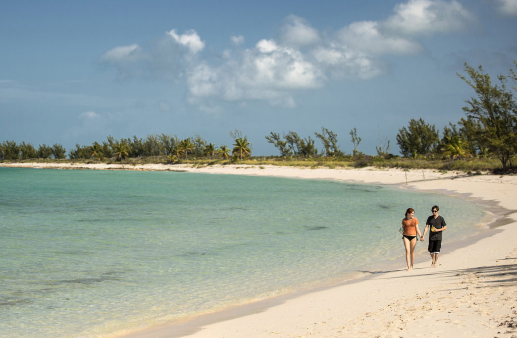 Adults find paradise all for themselves at Serenity Bay on Disney's private island paradise, Castaway Cay. This secluded part of the island offers adult guests a private beach, food and beverage area and private massage cabanas overlooking the sea. (Kent Phillips, photographer)