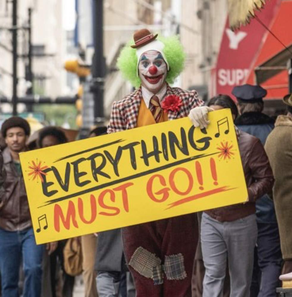 Joker holding sign